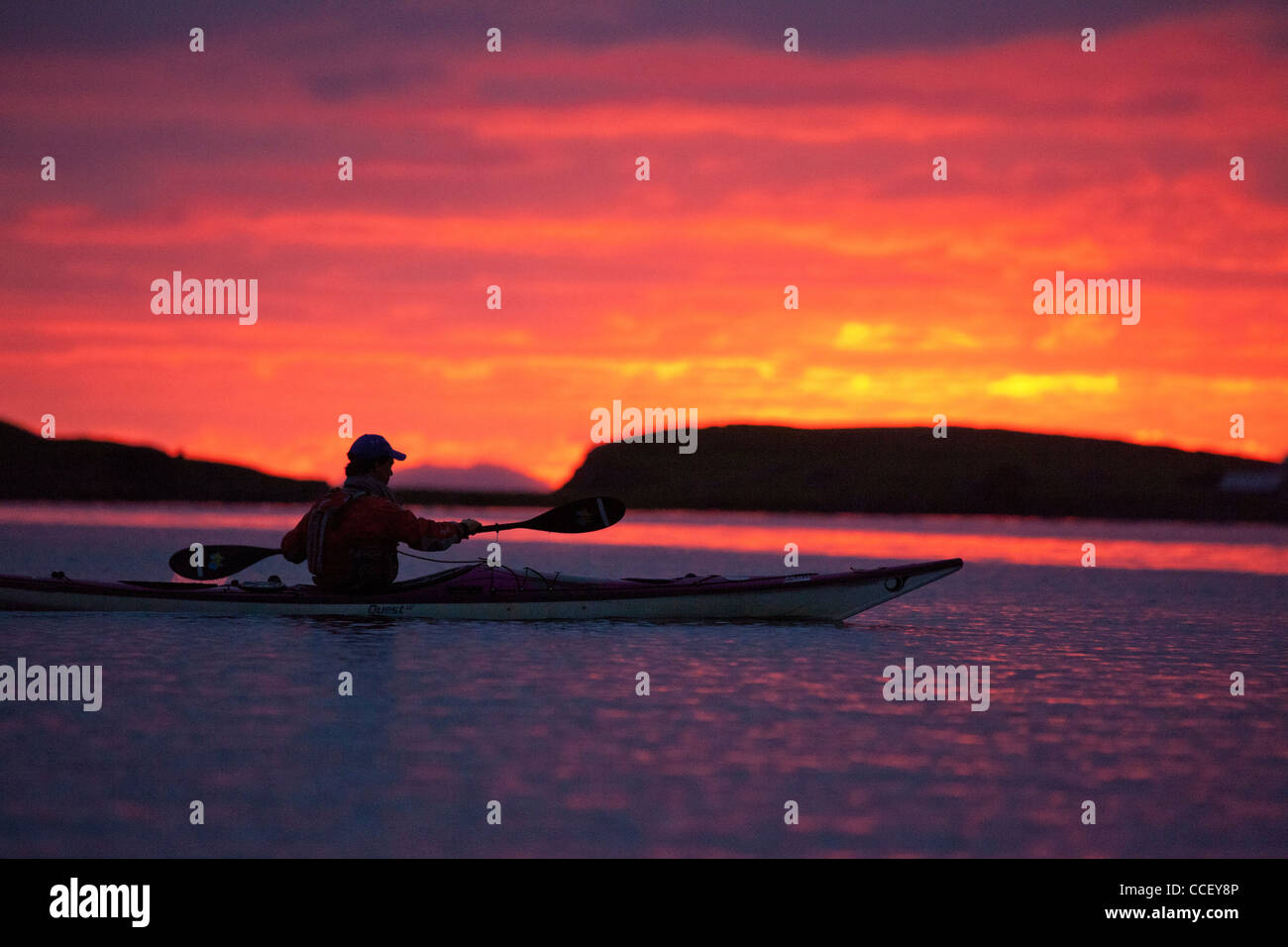 Sea kayaker at sunset in Clew Bay, County Mayo Ireland. - Stock Image