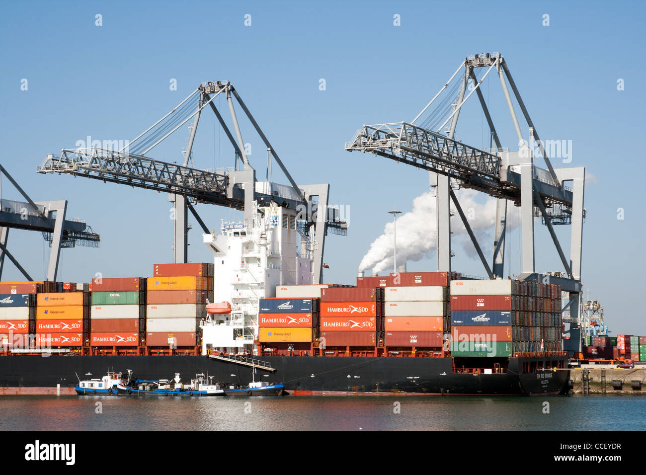 Container ship in the port of Rotterdam. - Stock Image