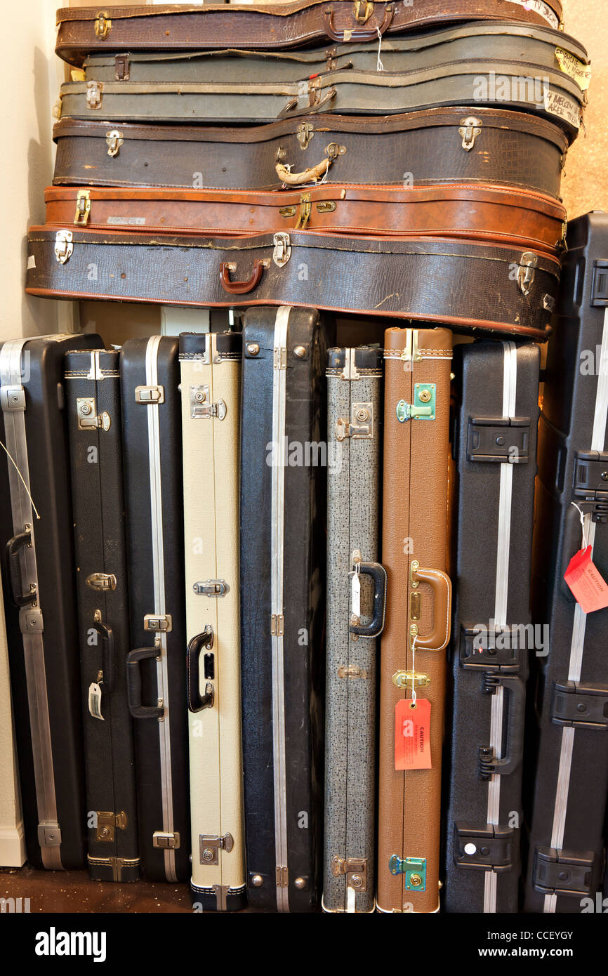 Group of old guitar case in music store - Stock Image
