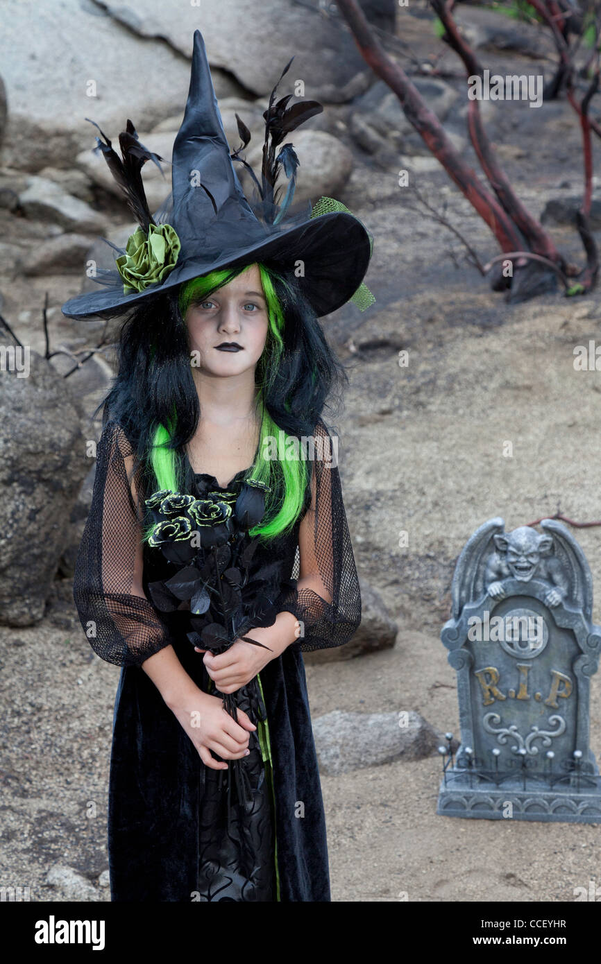 Portrait of young girl costumed as a witch - Stock Image