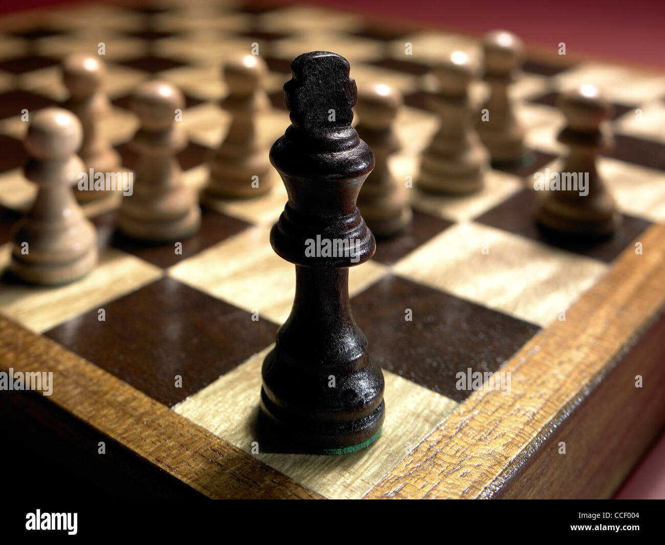 Chess pieces on a chessboard - Stock Image