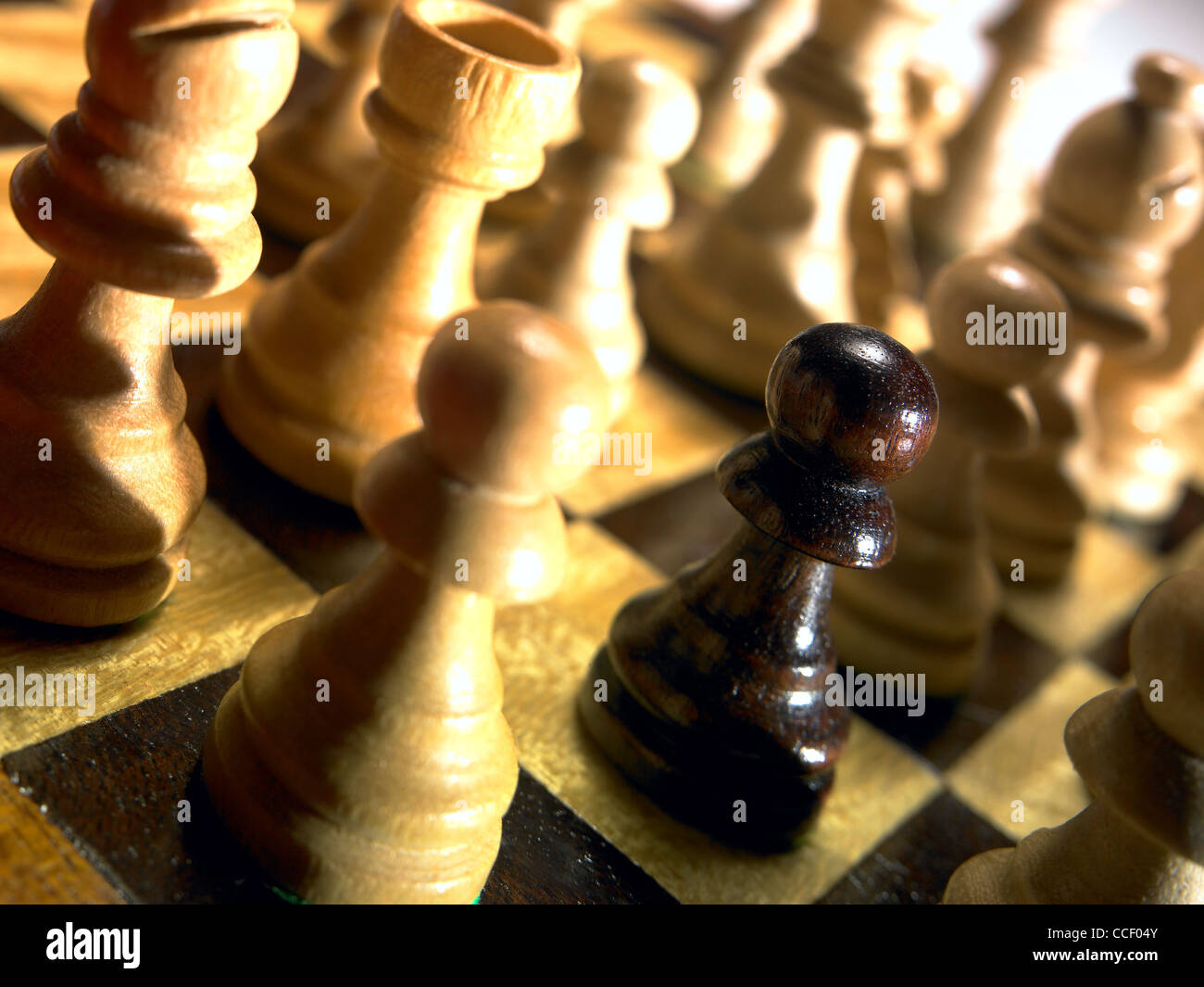 A pawn chess piece on a chessboard - Stock Image