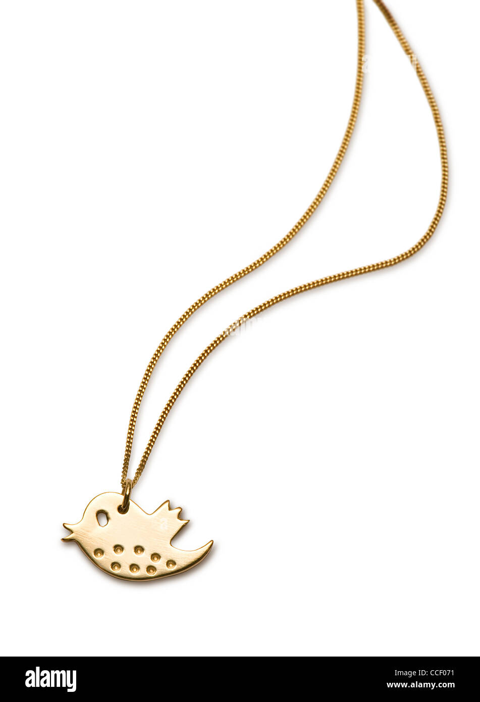 A gold twitter symbol pendant - Stock Image