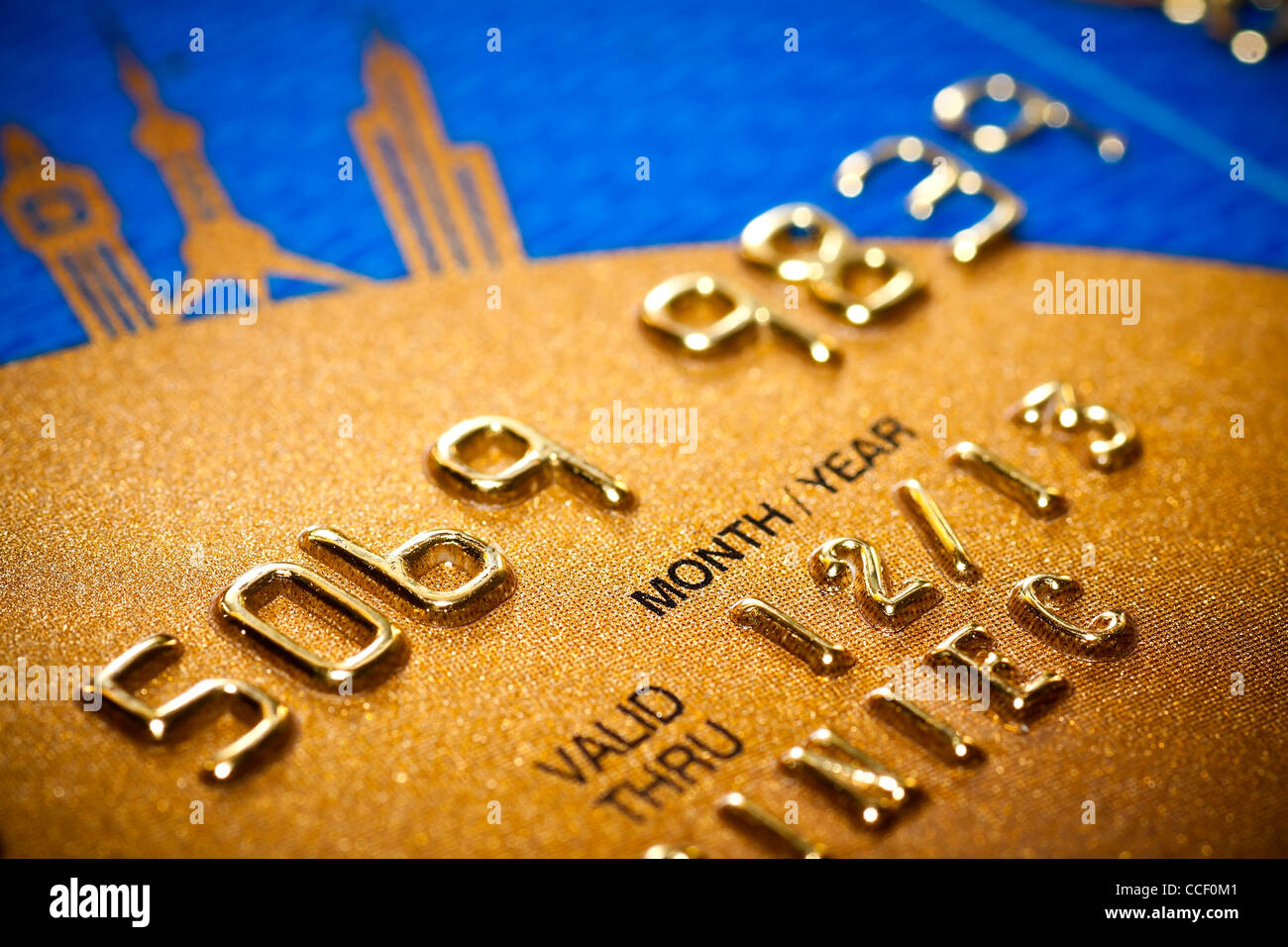 Close-up of silver digits on a credit card. - Stock Image