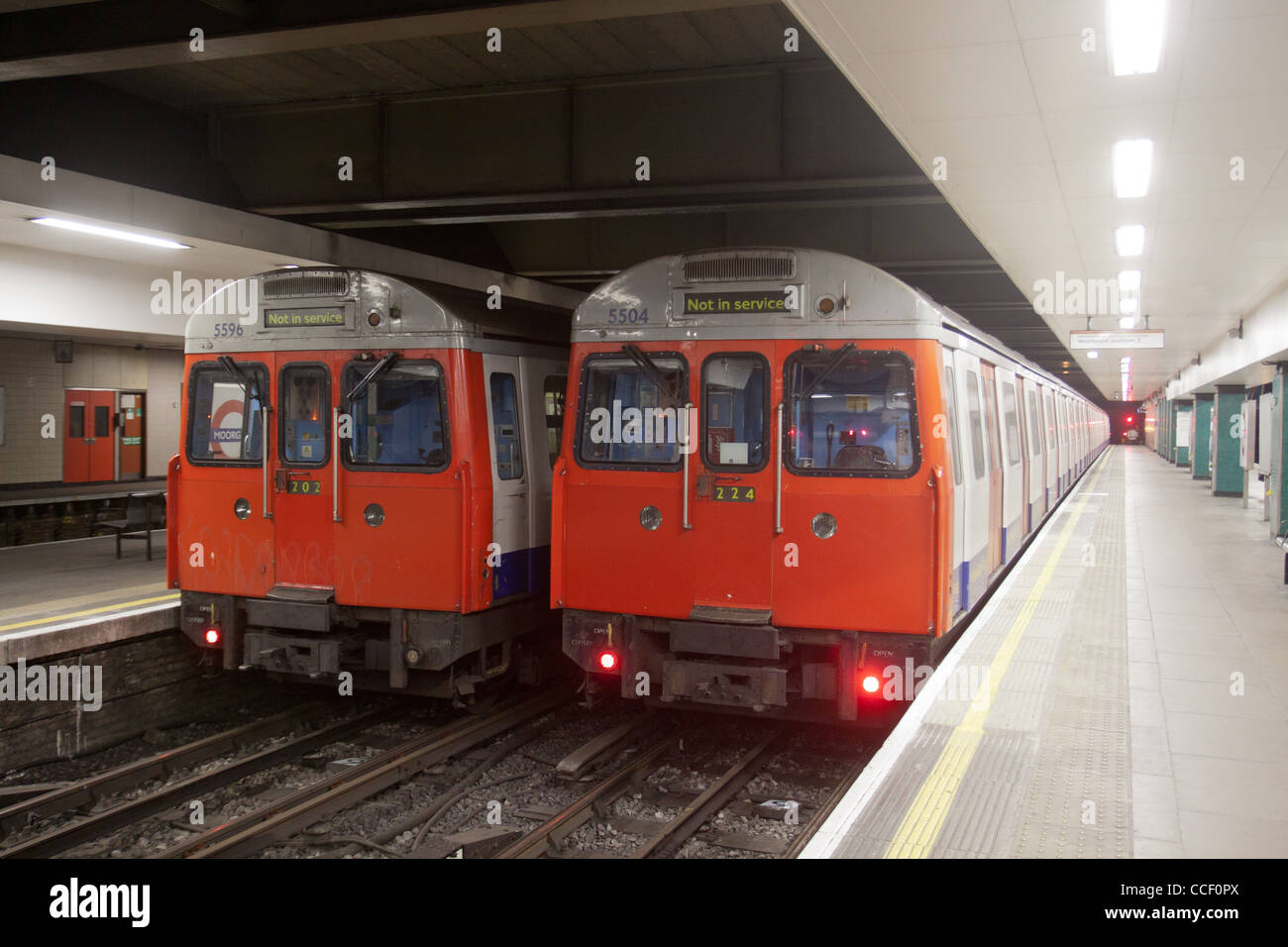 London Underground trains stopped in empty station - Stock Image