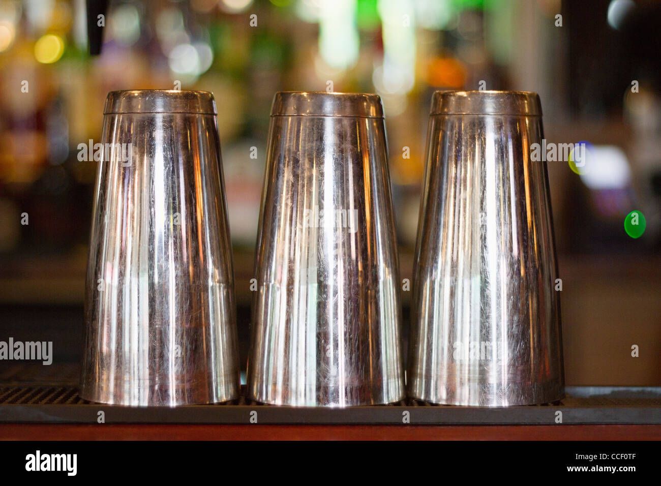 Close-up view of three steel glass kept upside down - Stock Image