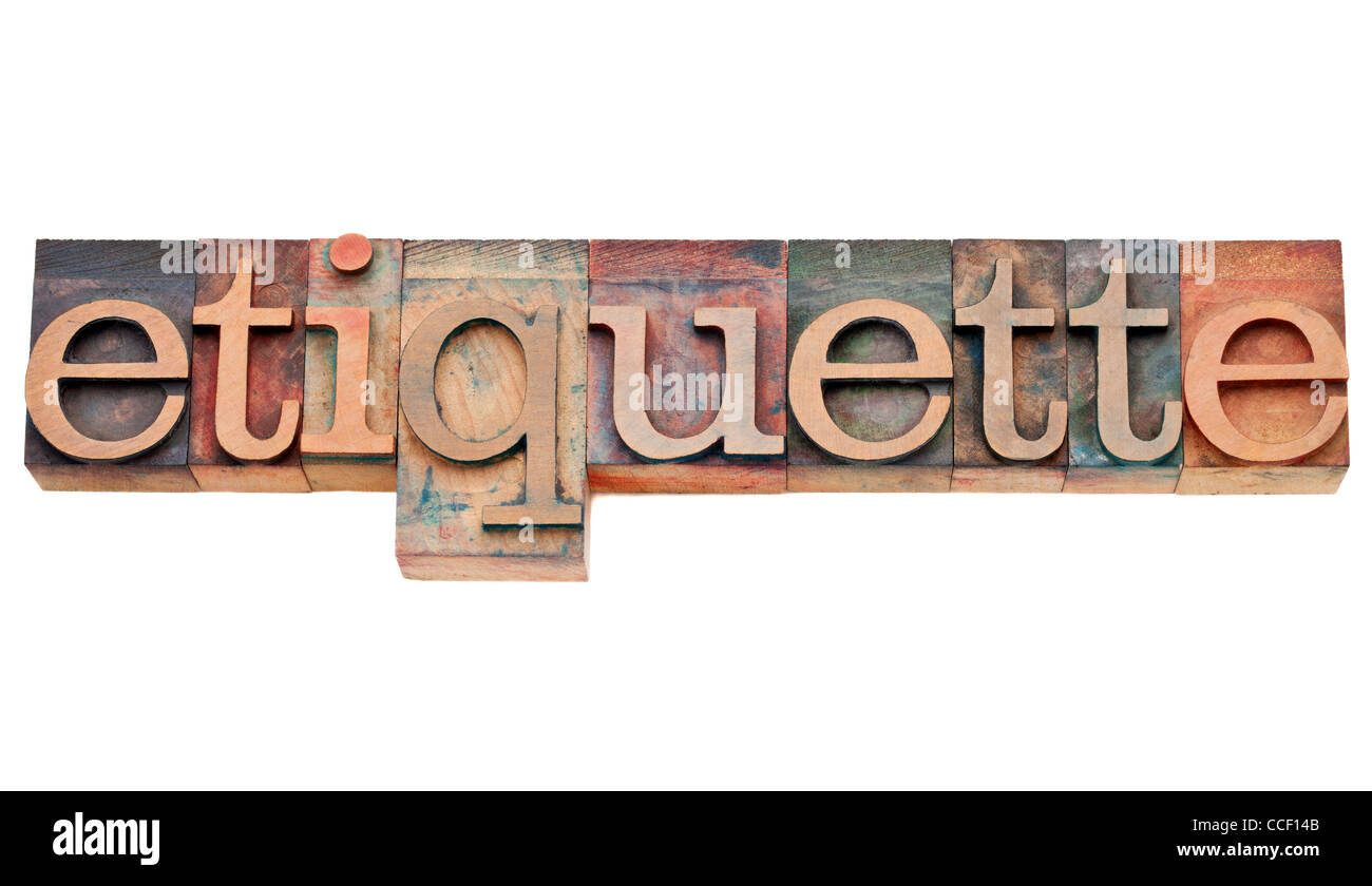 etiquette - courtesy or protocol concept - isolated text in vintage wood letterpress type, stained by color inks Stock Photo