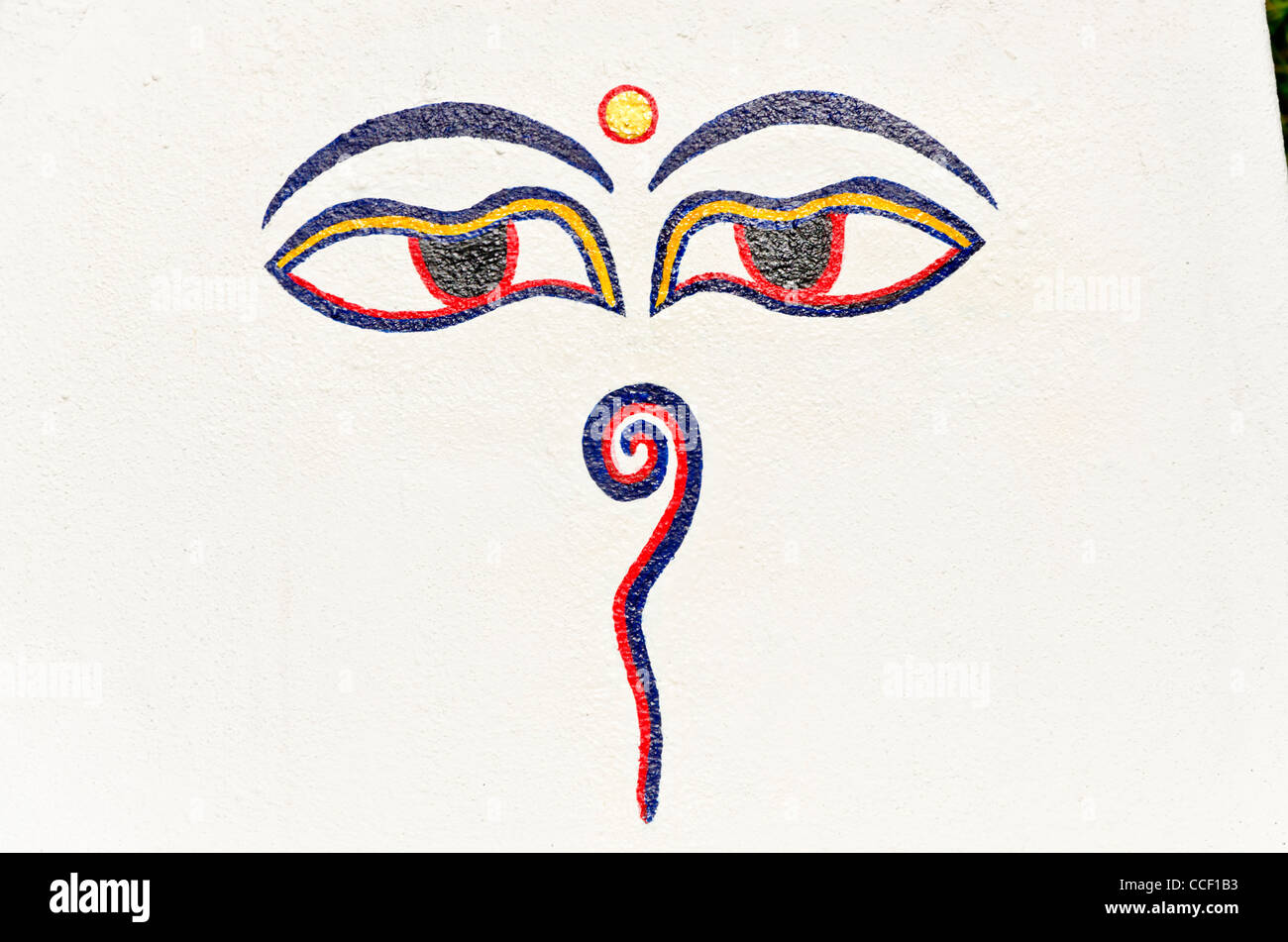Buddha Eyes, aka Wisdom Eyes painted on white wall - Stock Image