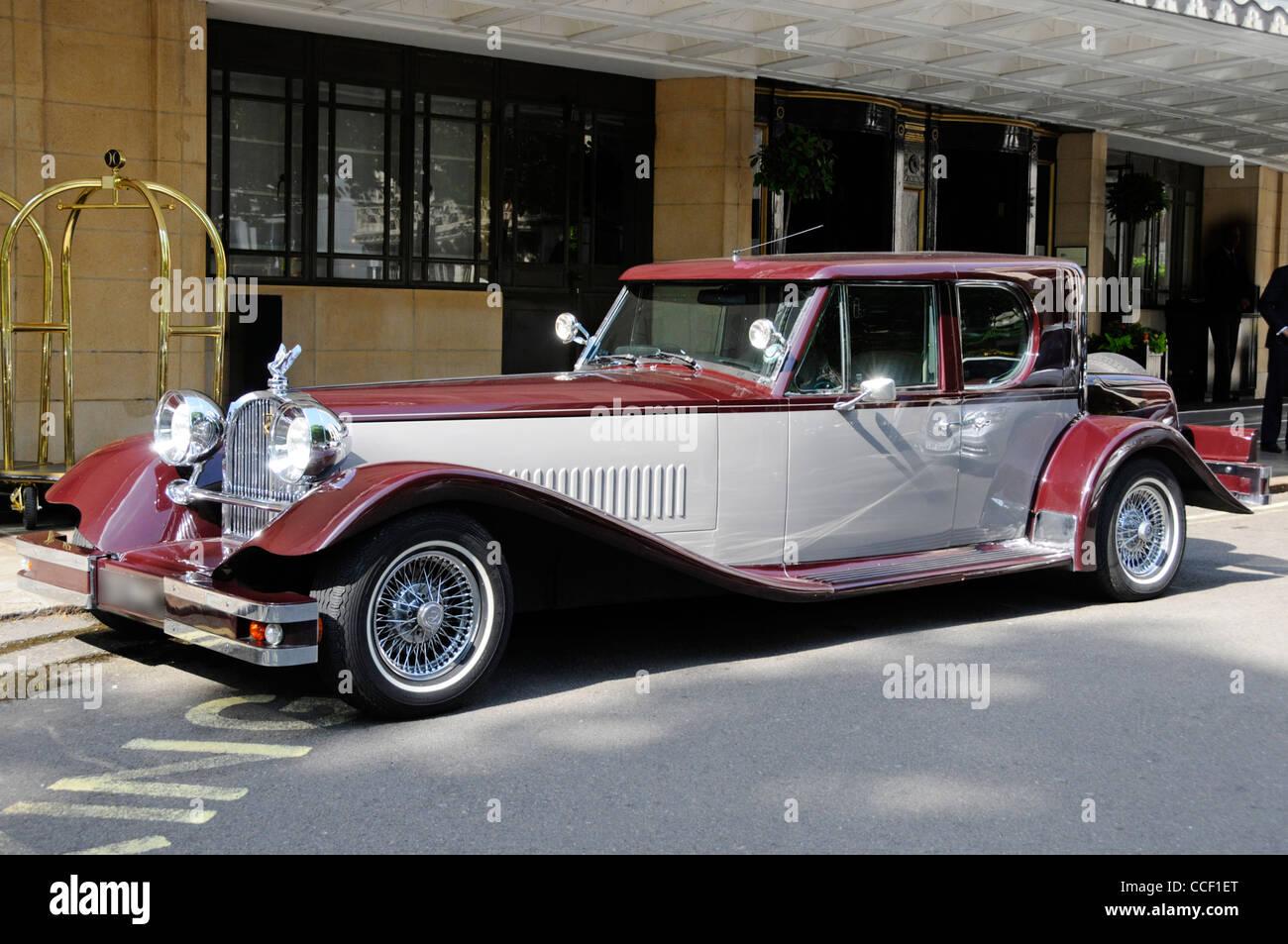 Side & front of custom built Buckingham V12 sports saloon