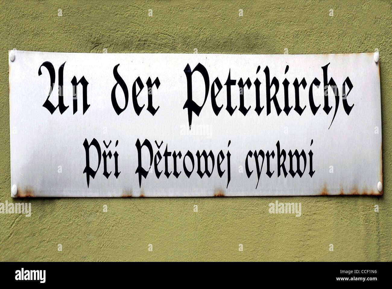 Street sign of Bautzen in German and Sorbian language at the Petrikirche - Pri Petrowej cyrkwi. - Stock Image