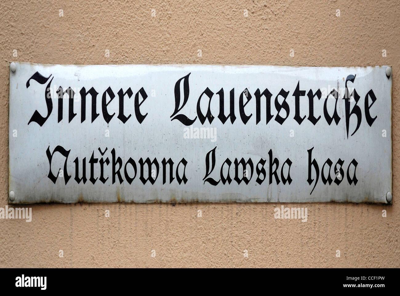 Street sign of Bautzen in German and Sorbian language at the Innere Lauenstrasse - Nutrkowna Lawska hasa. - Stock Image