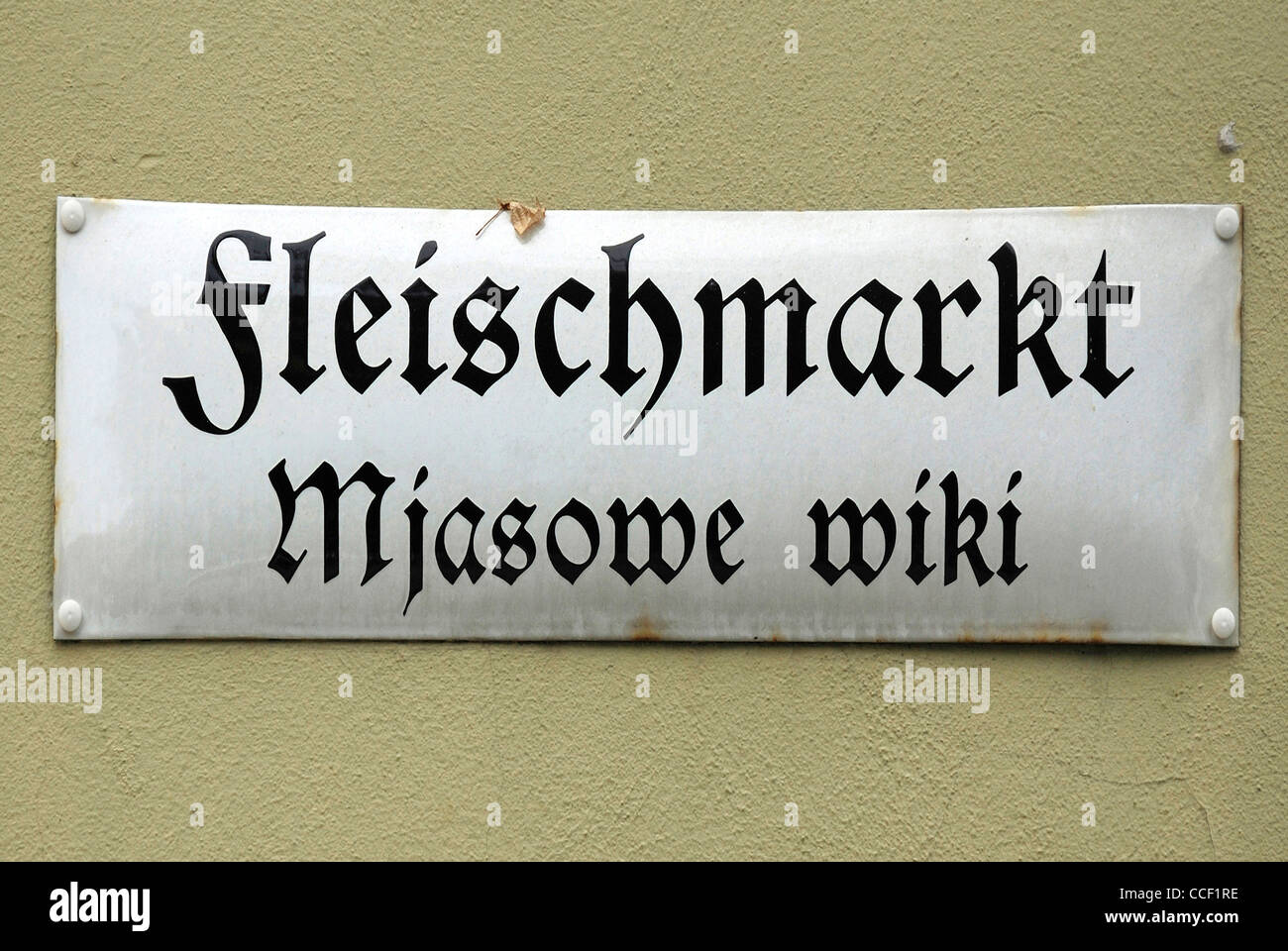 Street sign of Bautzen in German and Sorbian language on the Fleischmarkt - Mjasowe wiki. - Stock Image