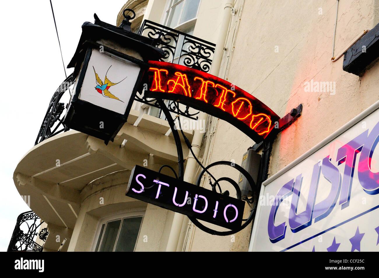 Detail of Tattooist's studio signs - Stock Image