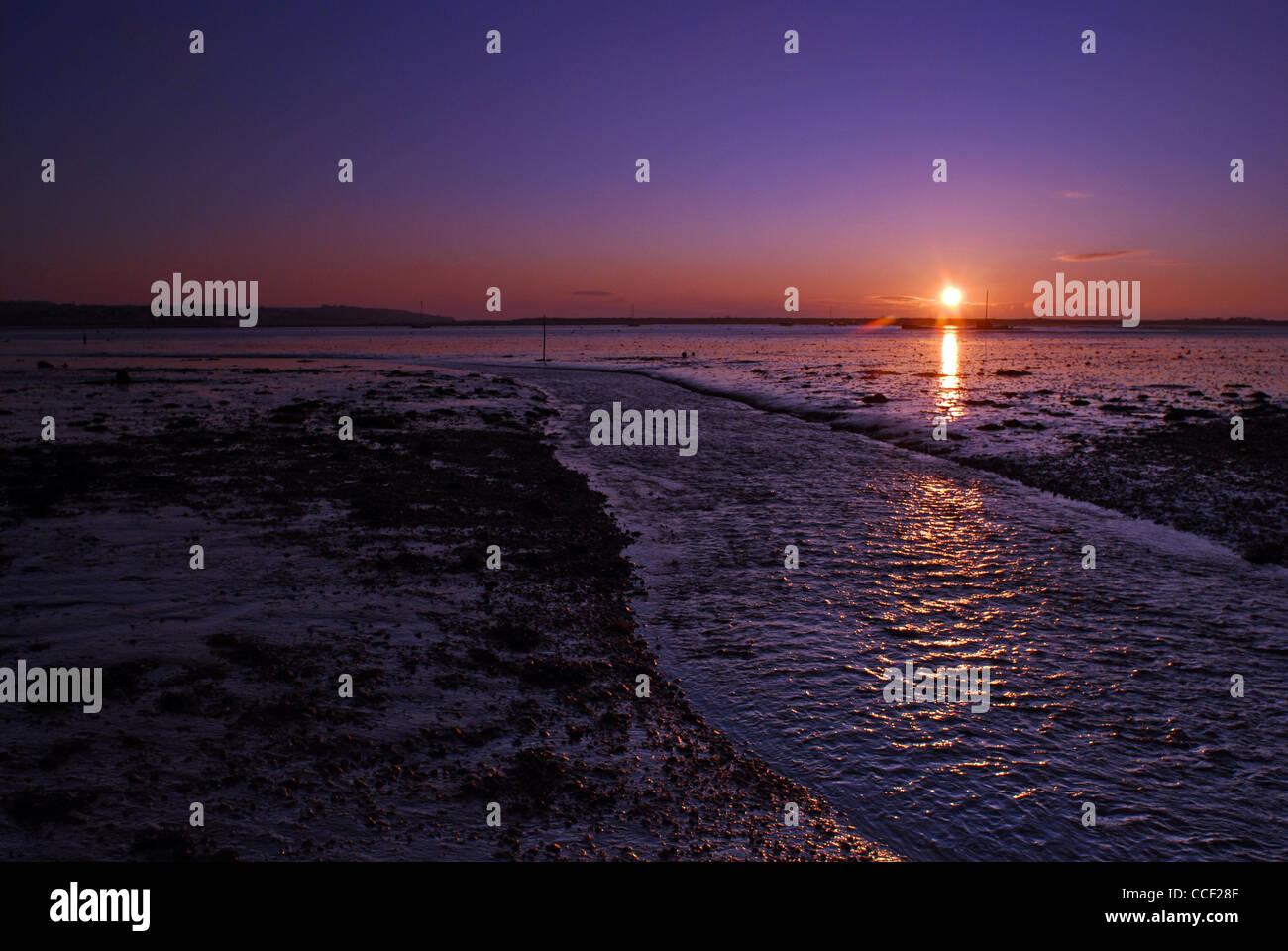 Sunrise over mudflats, Exe Estuary near Cockwood Harbour. Devon, England. - Stock Image