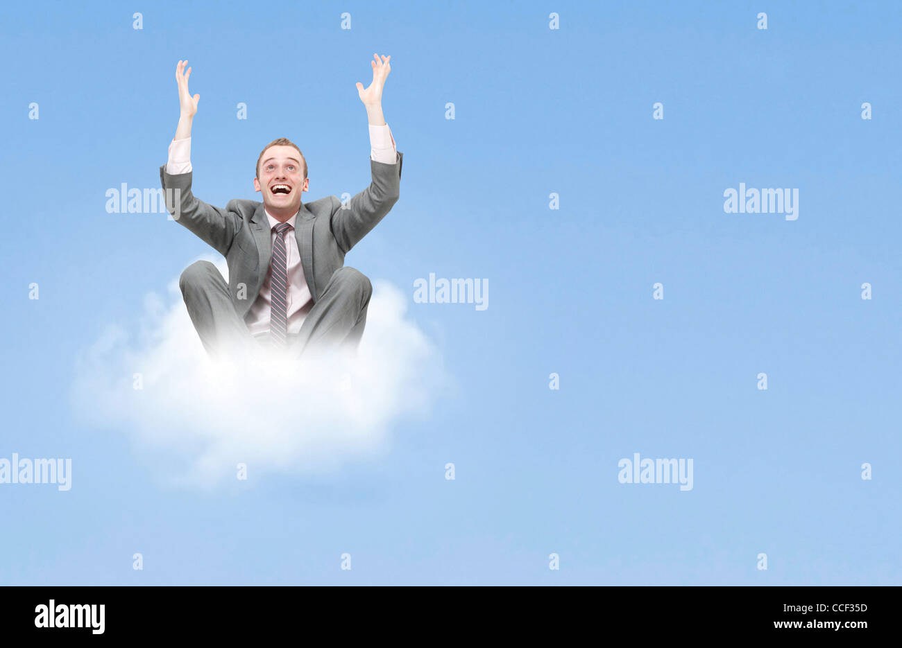 Business man on cloud - Stock Image