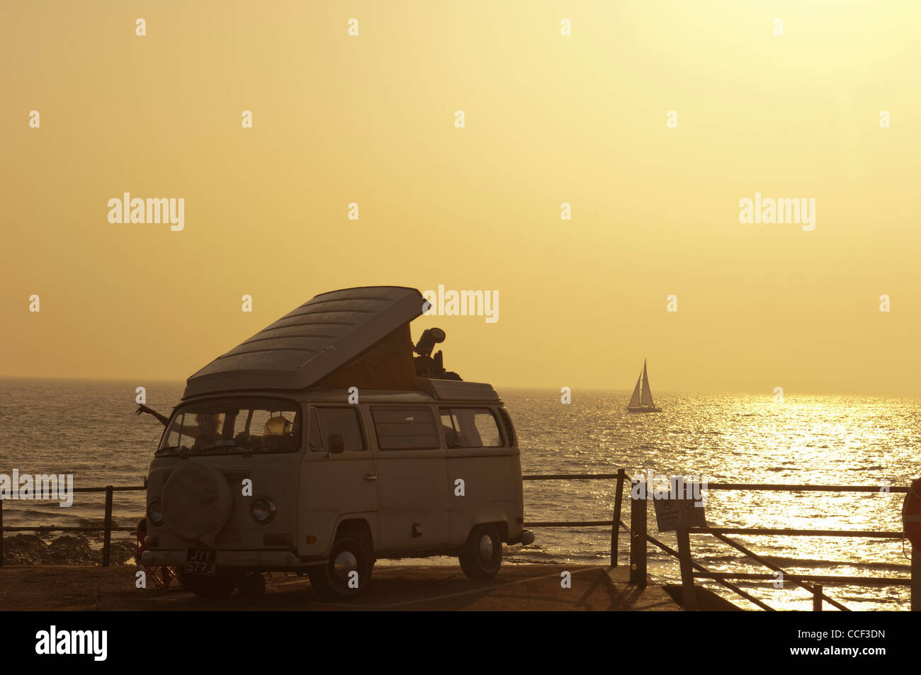 A VW camper van parked on the seafront at dawn. Broastairs. Isle of Thanet. Kent. England. UK - Stock Image