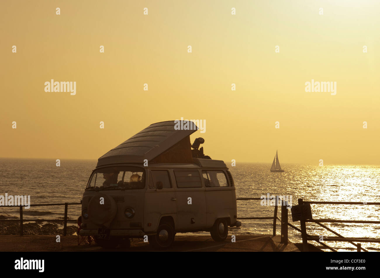 A VW camper van parked on the seafront at dawn. Broadstairs. Isle of Thanet. Kent. England. UK - Stock Image