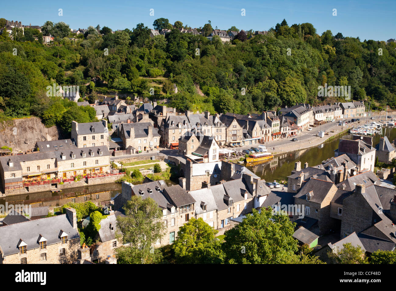 A view over the rooftops and River Rance at the medieval port of Dinan, Brittany, France. - Stock Image