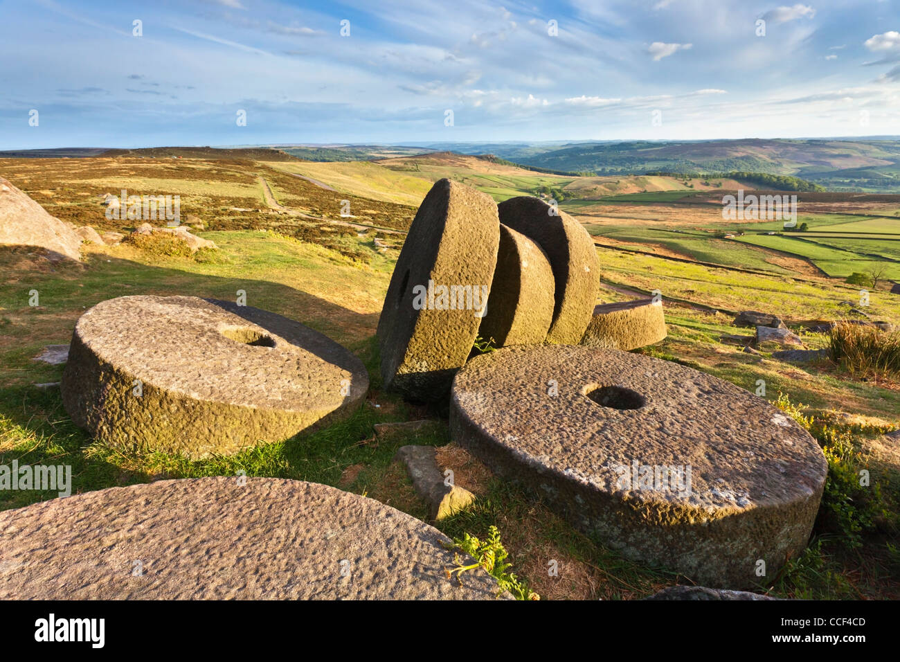 Millstones on Stanage Edge in the Peak District National Park. with the Hope Valley in the distance - Stock Image