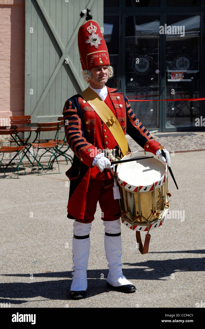 Drummer of the 'Potsdamer Riesengarde' in historical Prussian uniform on the Krongut Bornstedt in Potsdam. - Stock Image