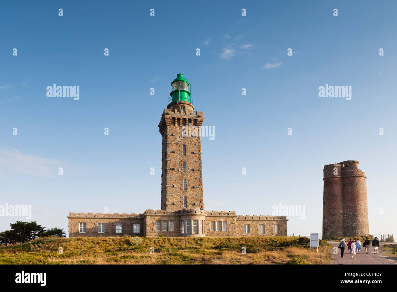 One of Brittany's many famous lighthouses, this is Cap Frehel lighthouse and semaphore in beautiful evening light. Stock Photo