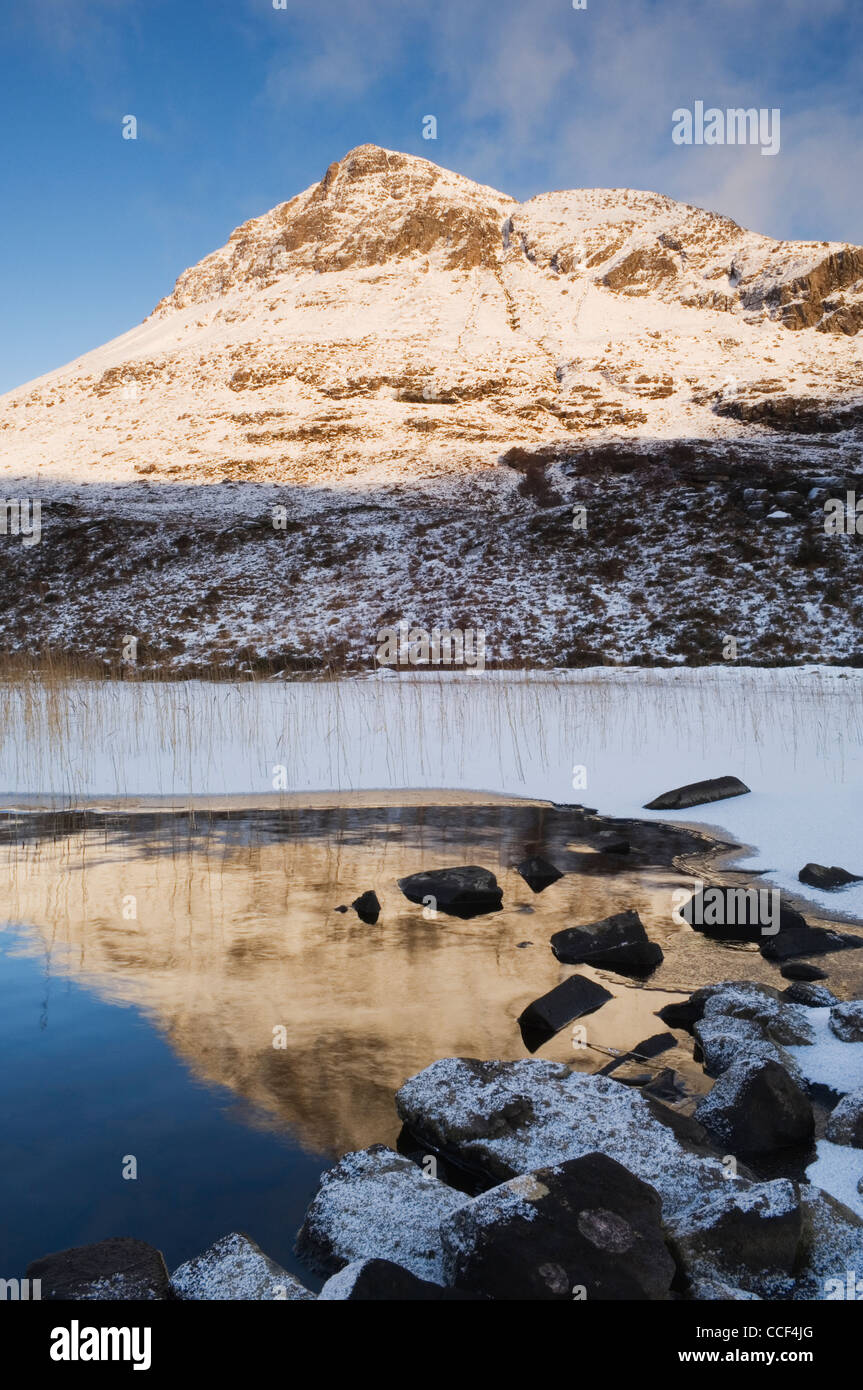 Cul Beag in winter from Loch Lurgiann, Inverpolly, Scotland. - Stock Image
