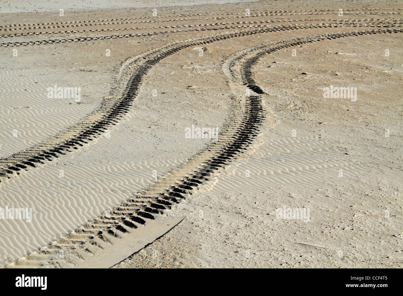 Tire tracks on the beach. Virginia Beach, VA, USA - Stock Image