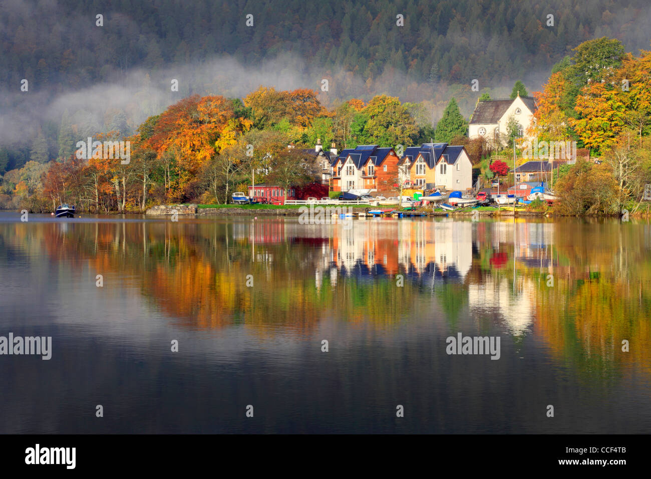 Kenmore reflected in Loch Tay, Scotland.  Captured on an atmospheric autumns morning - Stock Image