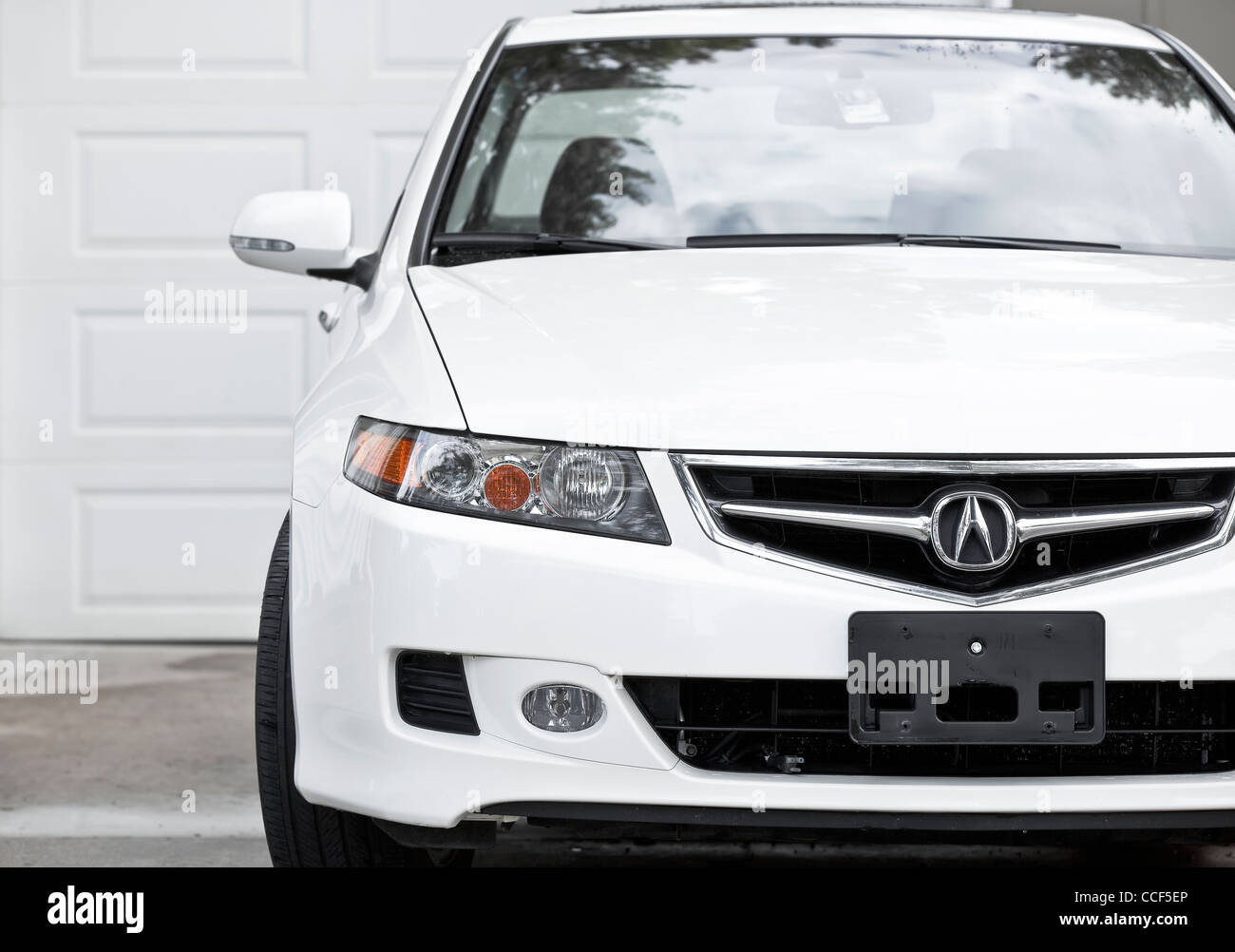 Acura Tsx sports sedan car, parked in driveway - Stock Image