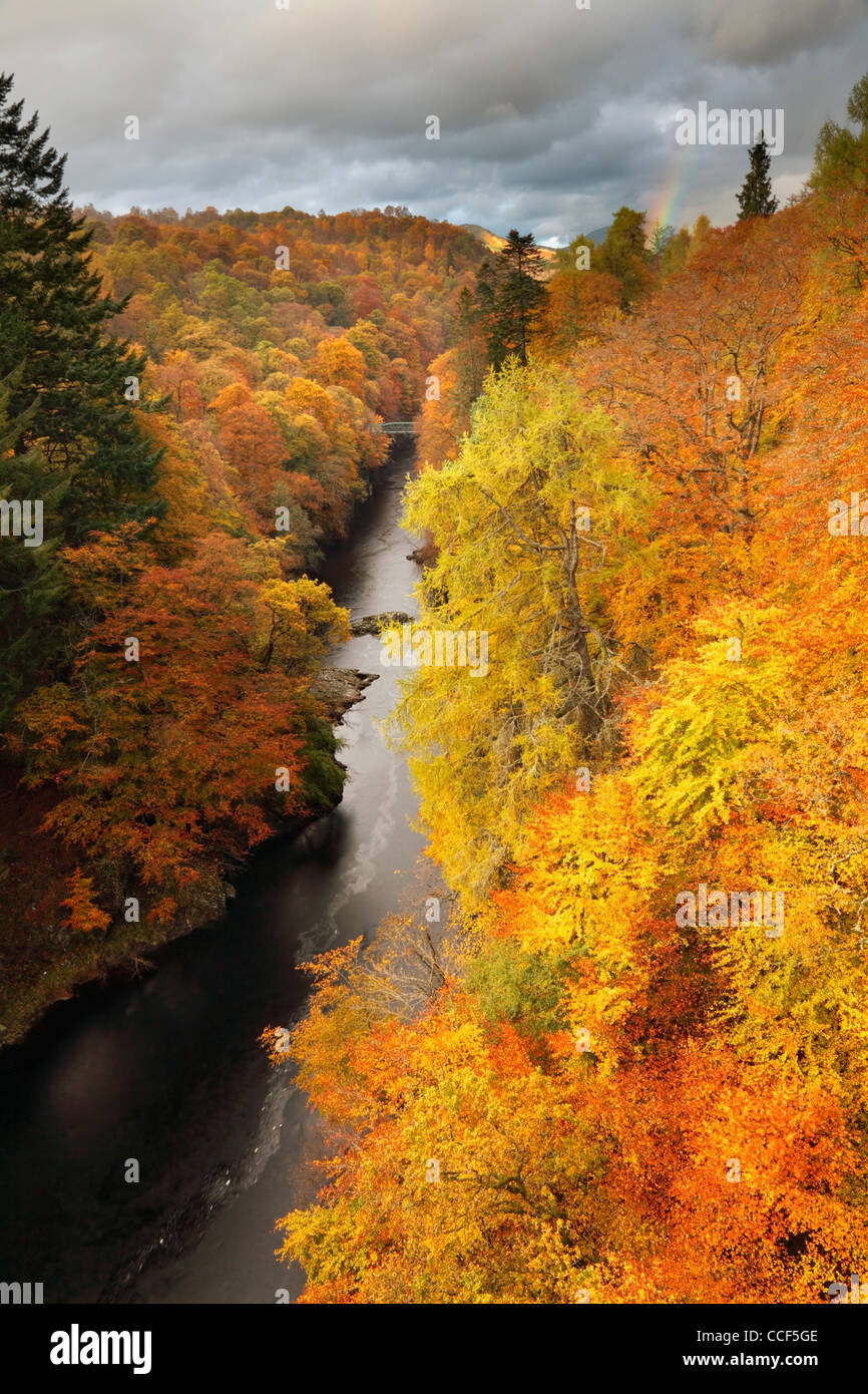 The Pass of Killiecrankie captured from the road bridge over the river Garry with a rainbow in the distance - Stock Image