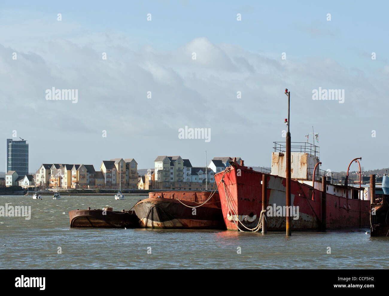 Barges and lighters tied up on the River Medway - Stock Image