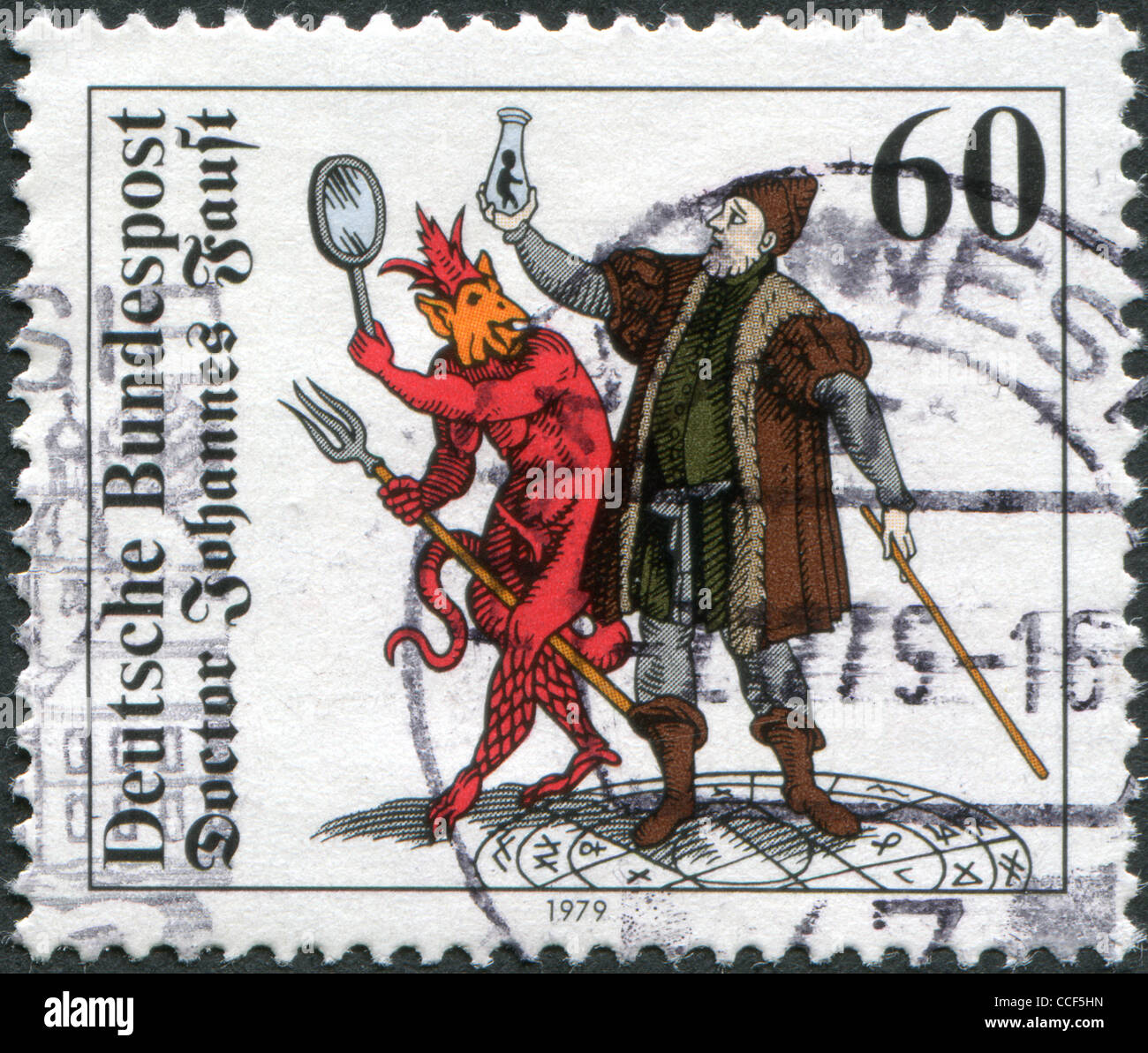 A stamp printed in Germany, show the Doctor Johannes Faust with Homunculus, Mephistopheles and Faust, Woodcut (1616), - Stock Image