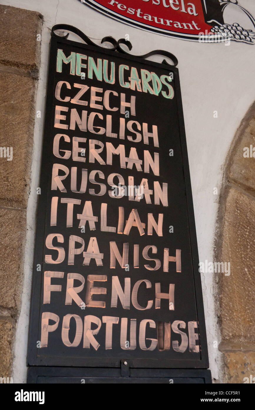 Restaurant blackboard with list of languages they have menu cards in Prague Czech Republic Europe EU - Stock Image