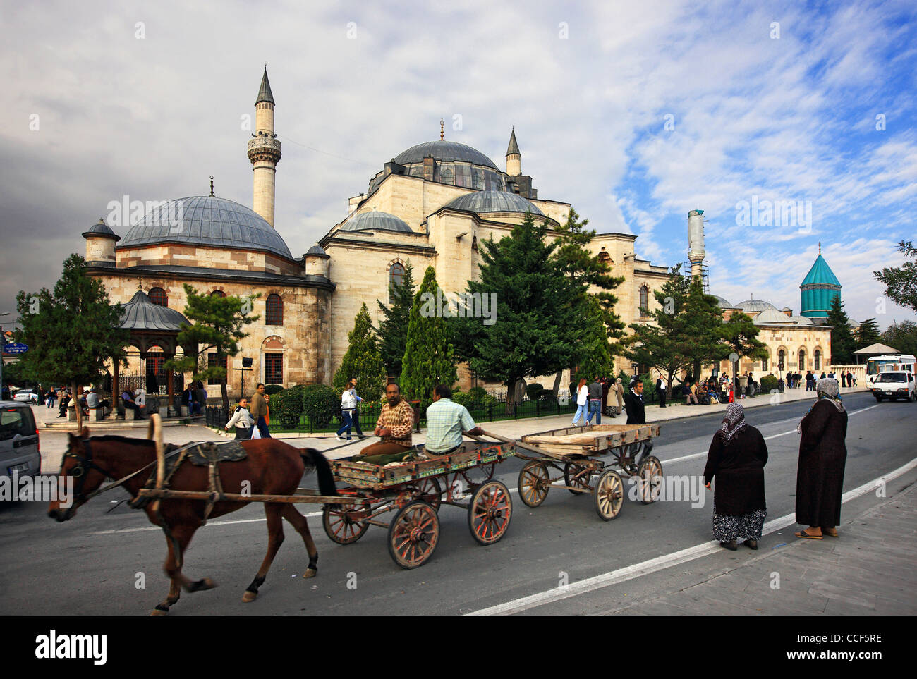 The Selimiye Camii (mosque), to the left and the turquoise dome of the Mevlana museum, Konya, Anatolia, Turkey - Stock Image