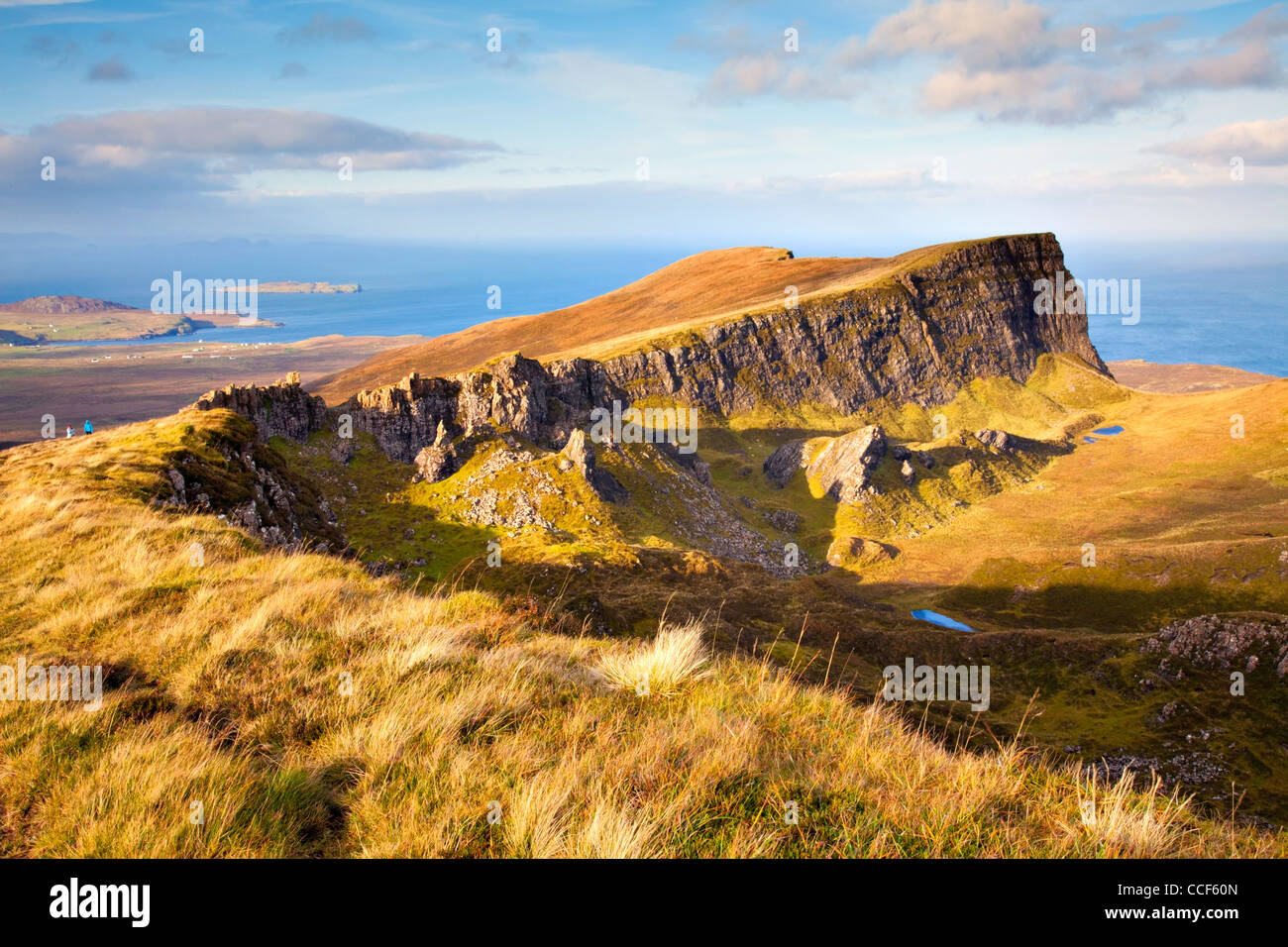 The Trotterish Ridge bathed in evening light at Fir Bhreugach, part of the popular circular  Quiraing walk on the - Stock Image