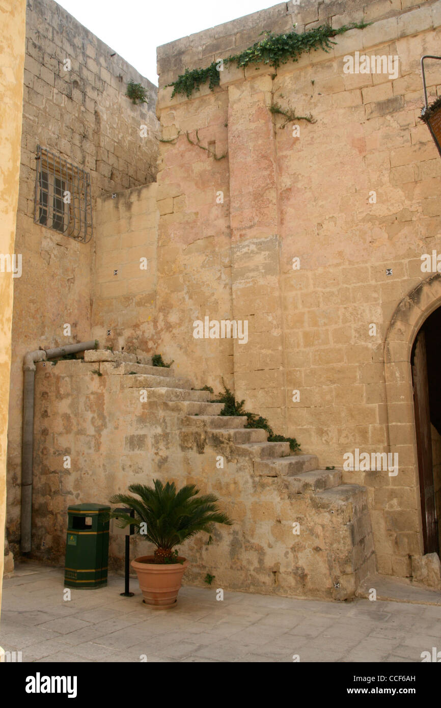 A staircase leading nowhere by a gateway in the ancient city of Mdina. - Stock Image
