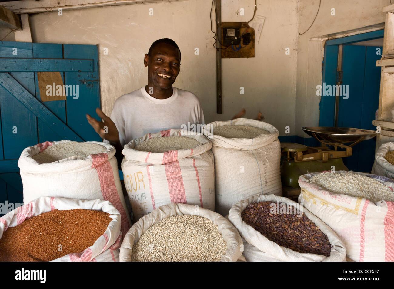 A man sells rice and pulses in Moshi Kilimanjaro Region Tanzania Stock Photo