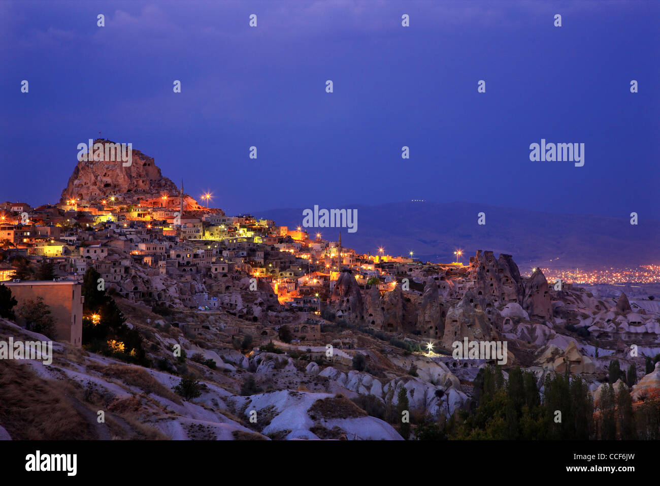 Beautiful Uchisar village with its spectacular rocky castle, at night. Nevsehir, Cappadocia, Turkey - Stock Image