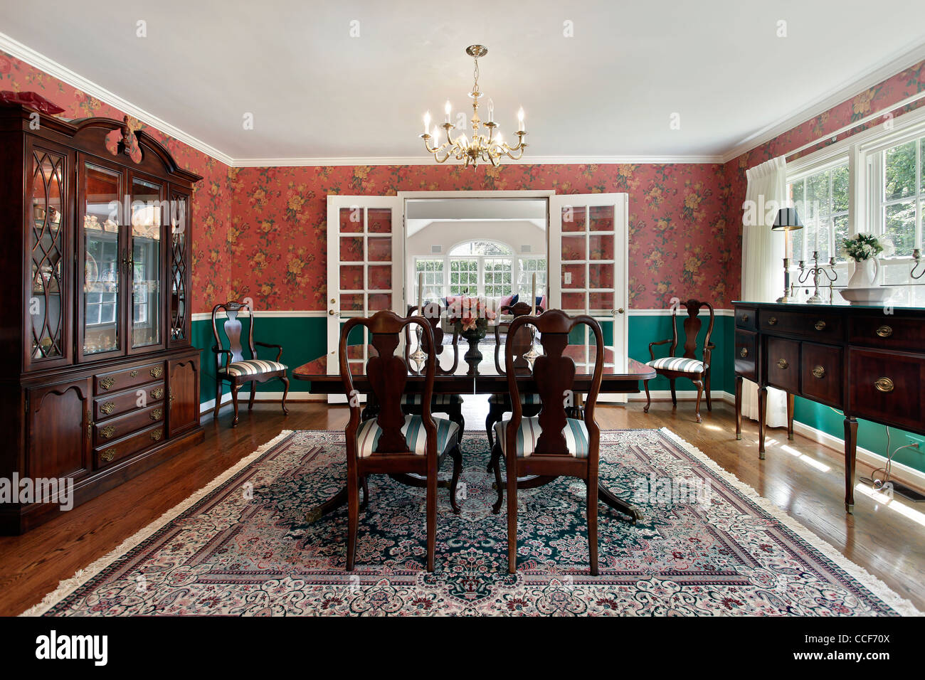 Formal Dining Room With French Doors And Red Walls