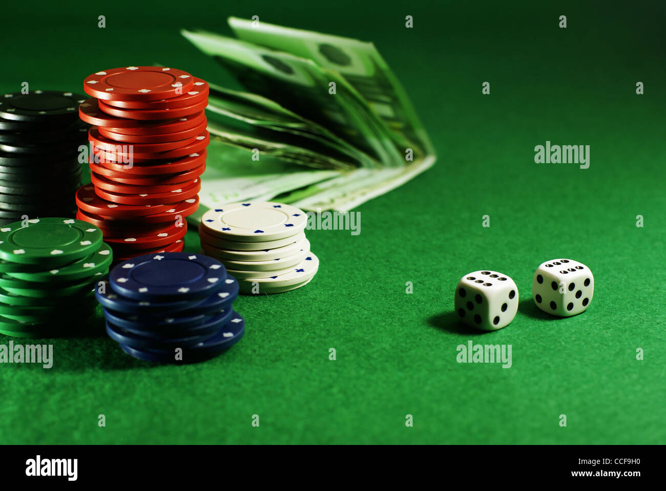craps on the green table with dibs and money - Stock Image