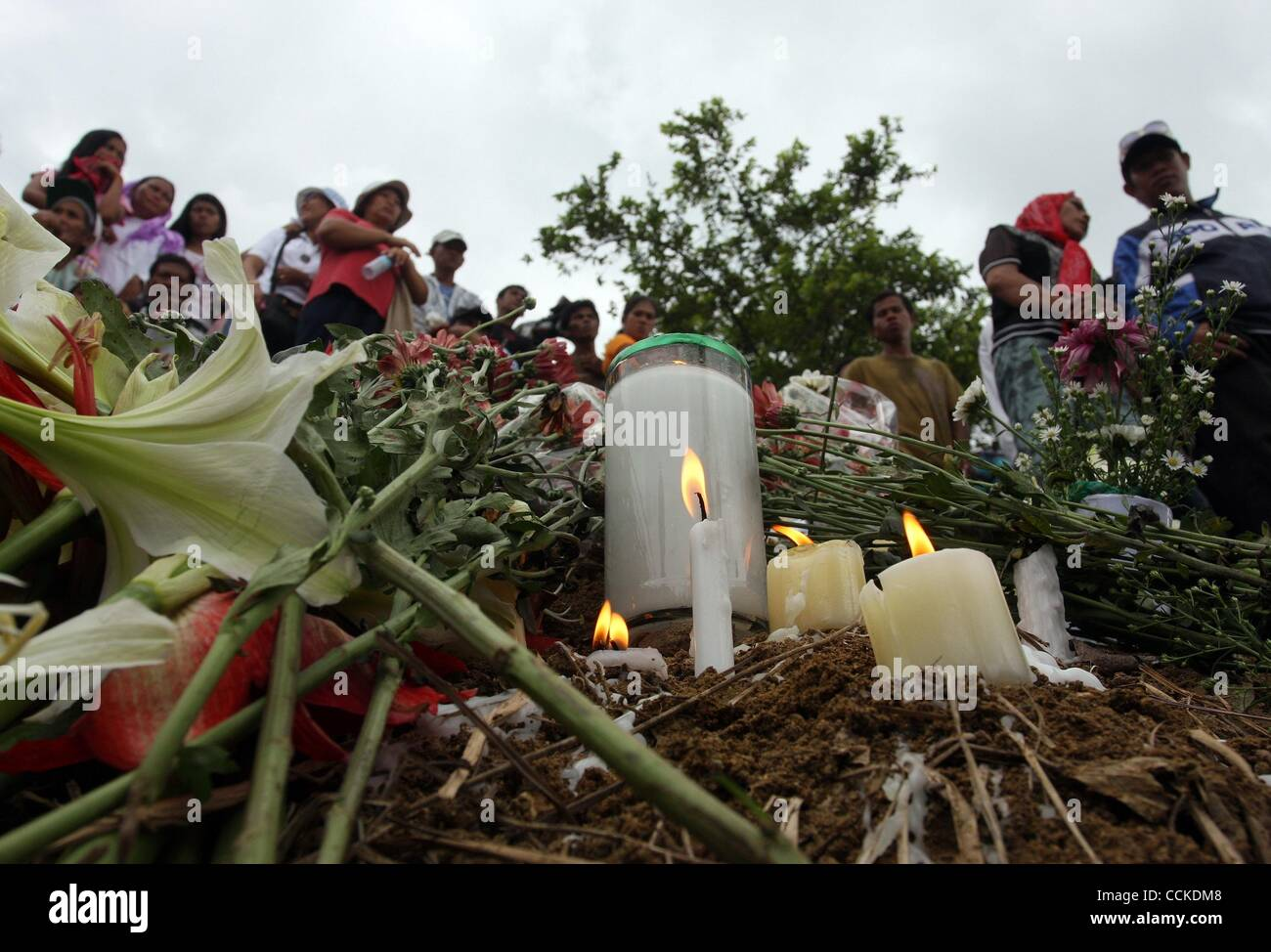 Nov 23, 2010 - Maguindanao , Philippines - Families, relatives, friends and militants light candles and offer flowers - Stock Image