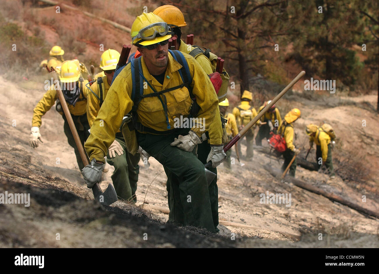 Jul 16, 2004; Carson City, CA, USA; Bureau of Indian Affairs firefighter DAVE CURNS leads a squad of his peers on a search for hotspots Friday, July 16, 2004 in the Lakeview Estates area of Carson City, Nevada. Hilly terrain, whipping winds and erratic fire behavior continued to challenge crews batt Stock Photo