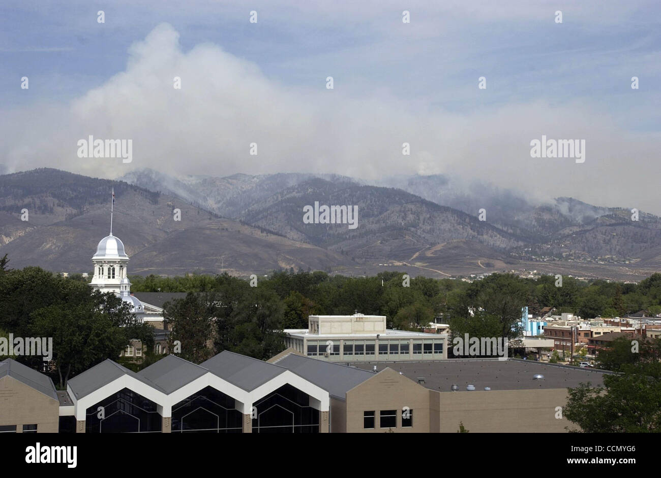 Jul 16, 2004; Carson City, CA, USA; The Waterfall fire continued to burn on the West side of Carson City Friday, July 16, 2004. The fire at one point threatened the Nevada Capitol along the Southern part. Stock Photo