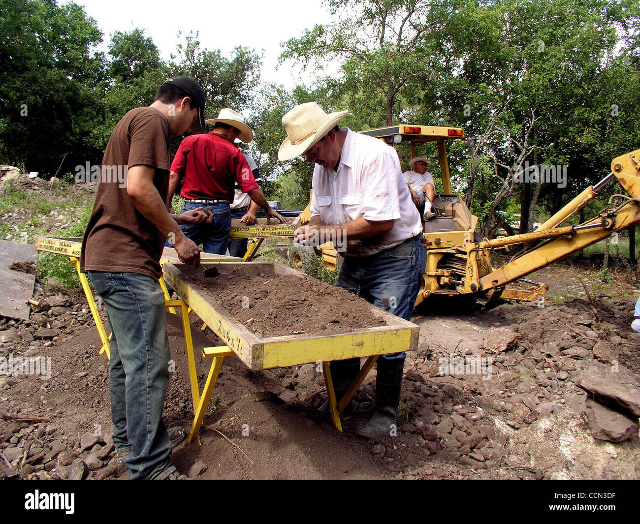 METRO - Francois Dengah, left, and Andy Besa look for evidence of early Native Americans during an archaelogical Stock Photo