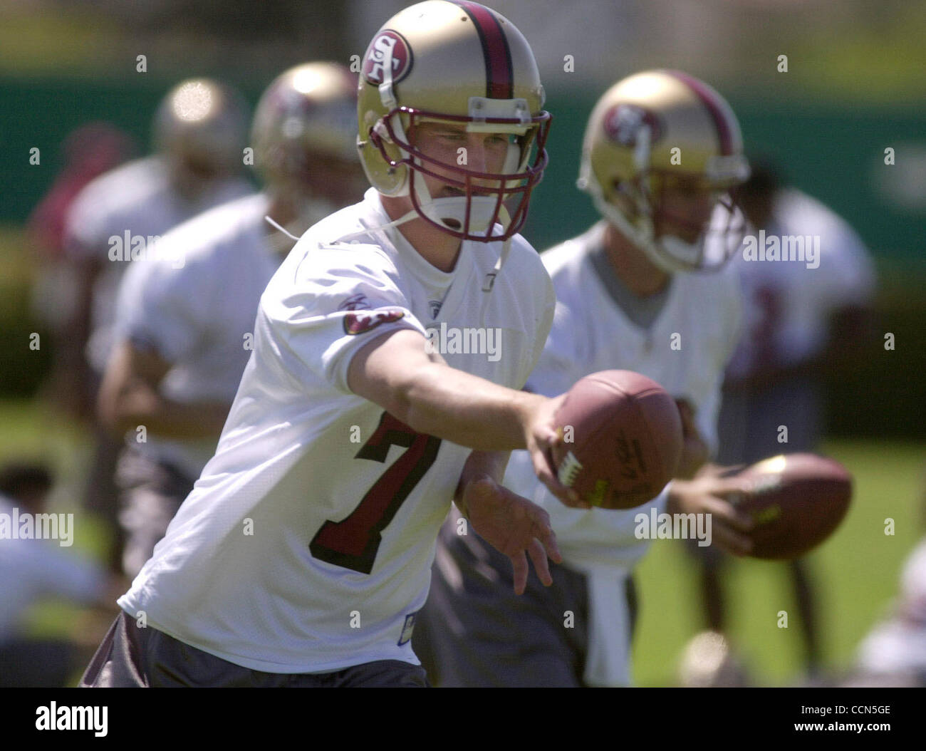San Francisco 49er quarterback Ken Dorsey hands off the ball on the first day of 49ers training camp, Friday, July - Stock Image