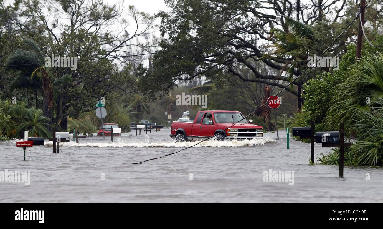 090504 VERO BEACH, FL -A truck drives past mailboxes on a flooded