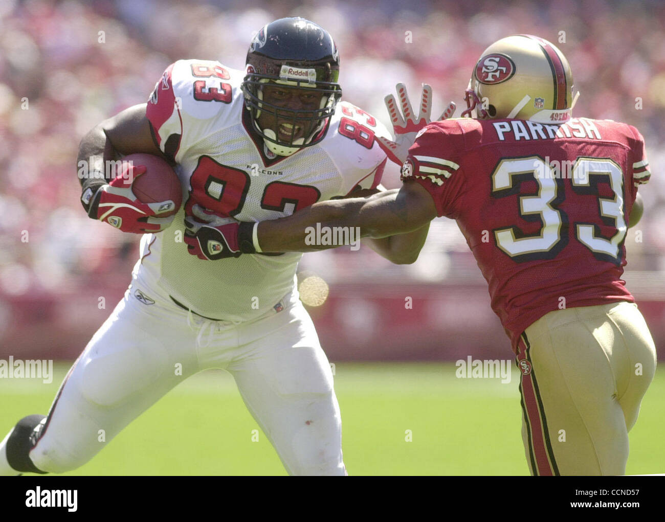 San Francisco 49er #33 Tony Parrish is unable to stop       Atlanta's #83 Alge Crumpler in the first quarter - Stock Image