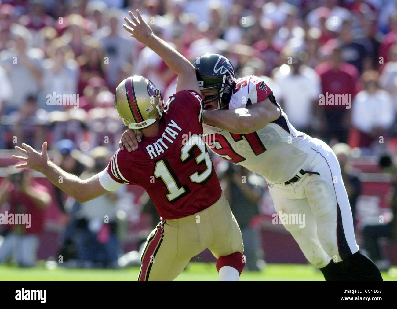 San Francisco 49er Tim Rattay is brought down by     Atlanta's #97Patrick Kerney in the second half Sunday, - Stock Image