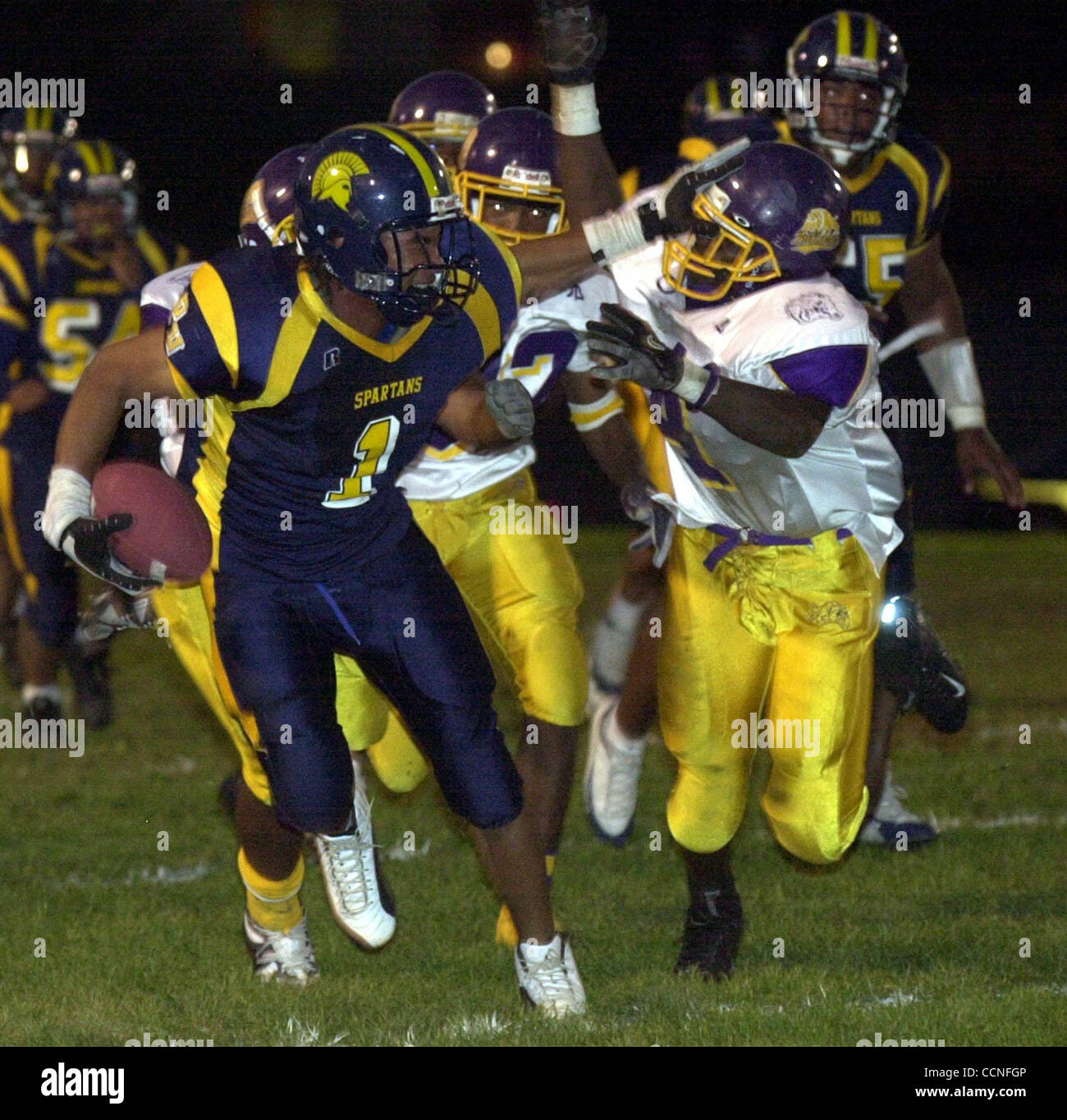 (l to r) Brenton Thompson of the Pinole Valley High stiff arms Marcel Mamon of the Oakland Tech as runs for a long - Stock Image