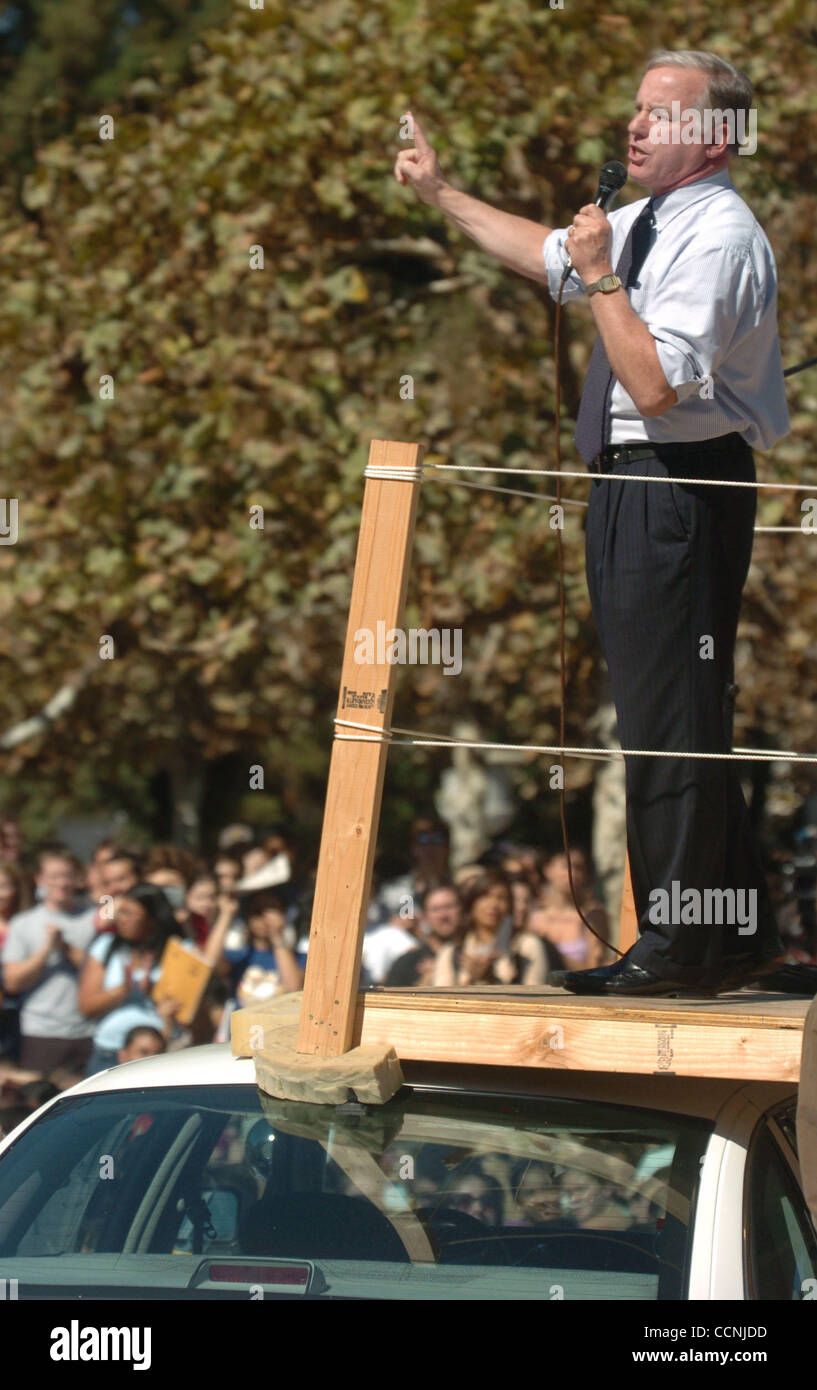 On top of a police car, former governor of Vermont, Howard Dean, encourages the crowd to vote in the upcoming election Stock Photo